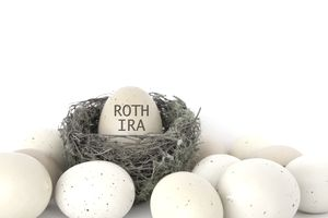 Egg labeled Roth IRA sitting in a bird's nest.
