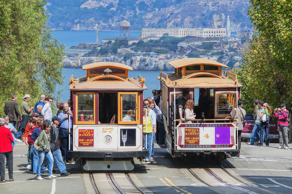 Tourists getting off cable cars