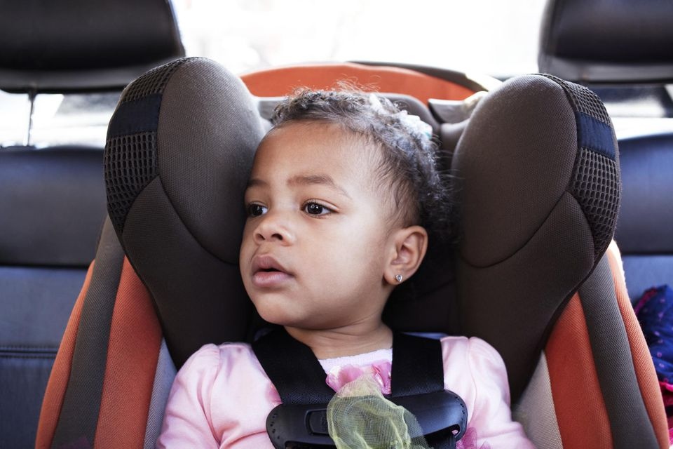 Small Girl in Child Seat