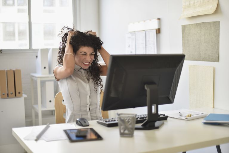 Frustrated woman at her desk