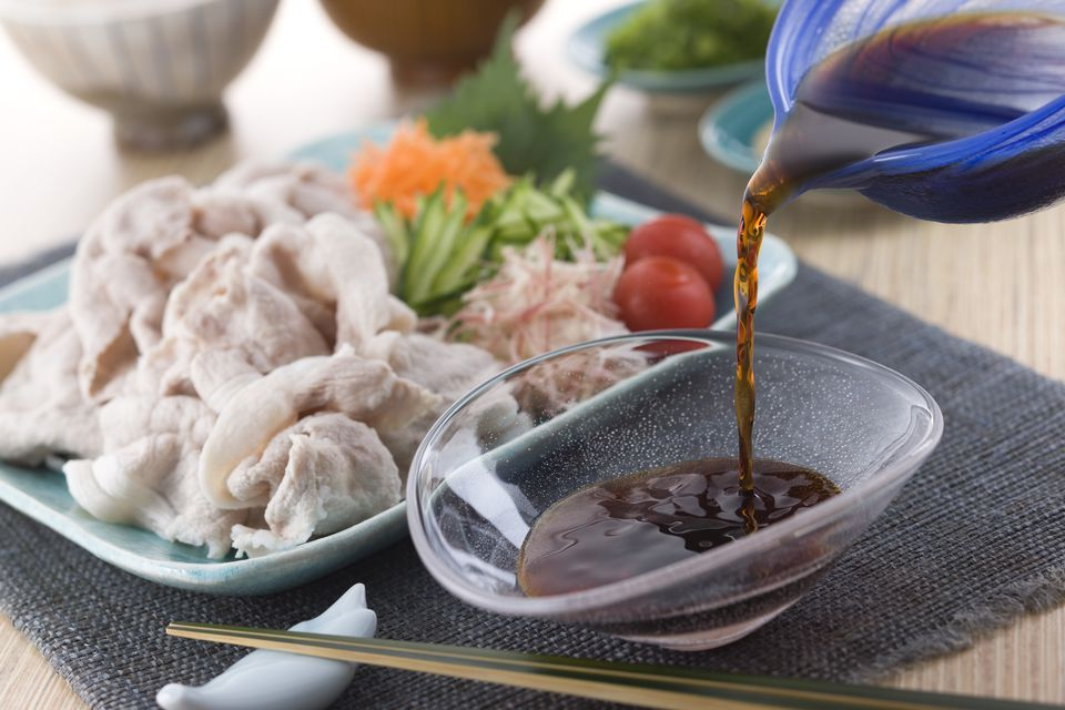 Pouring Ponzu sauce onto Plate