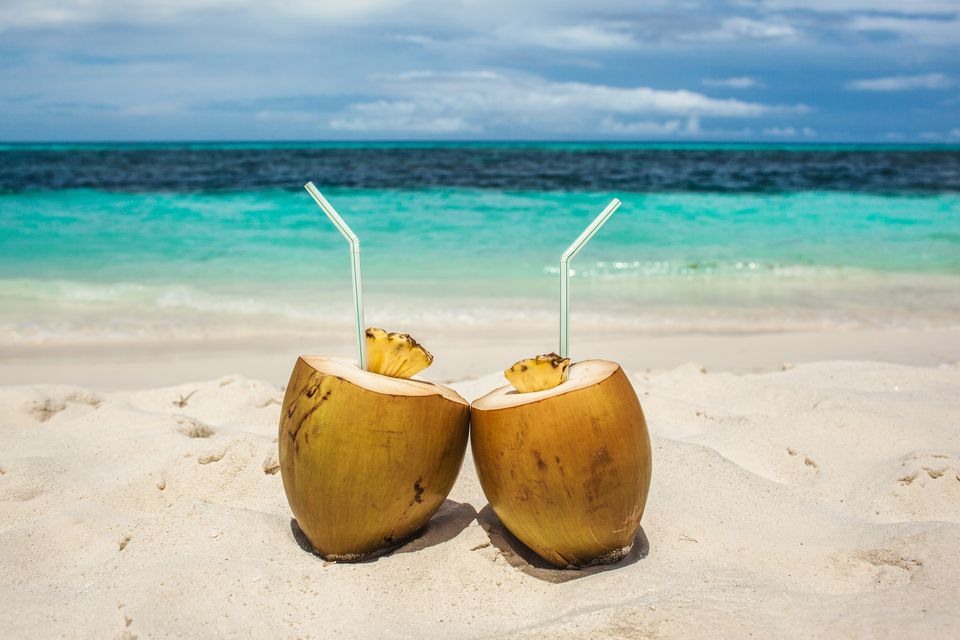coconut drinks on beach in Maldives, vacation in paradise, sunny day in topical island