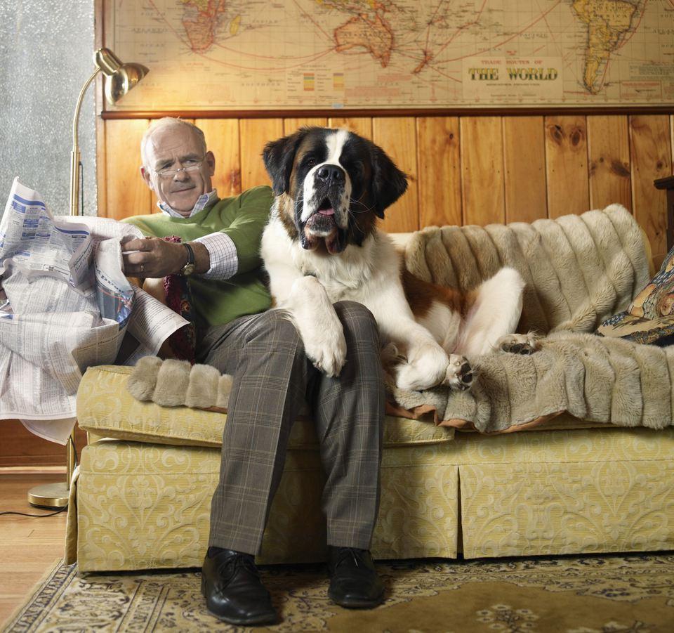 man annoyed by dog