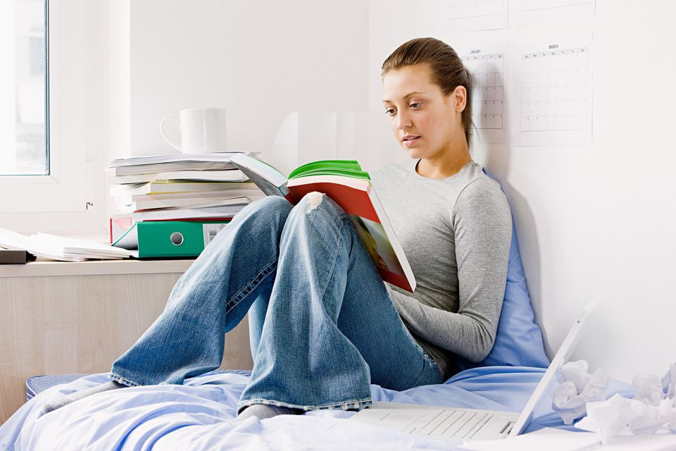 Student reading in room