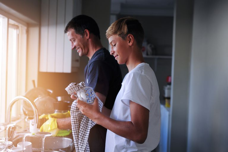 dad and son washing dishes