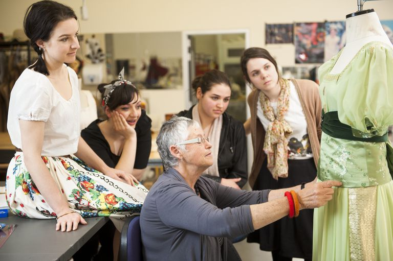 Senior lecturer teaches students dressmaking skills