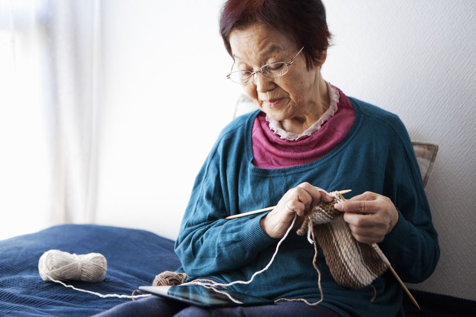 An old woman knitting