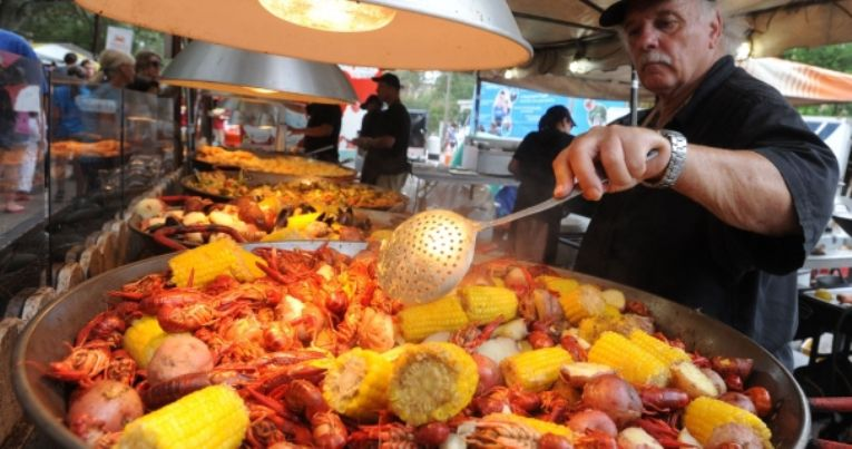 Man serving up seafood at Pensacola Seafood Festival