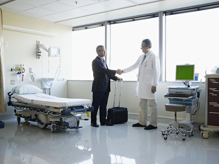 Medical sales representative with doctor