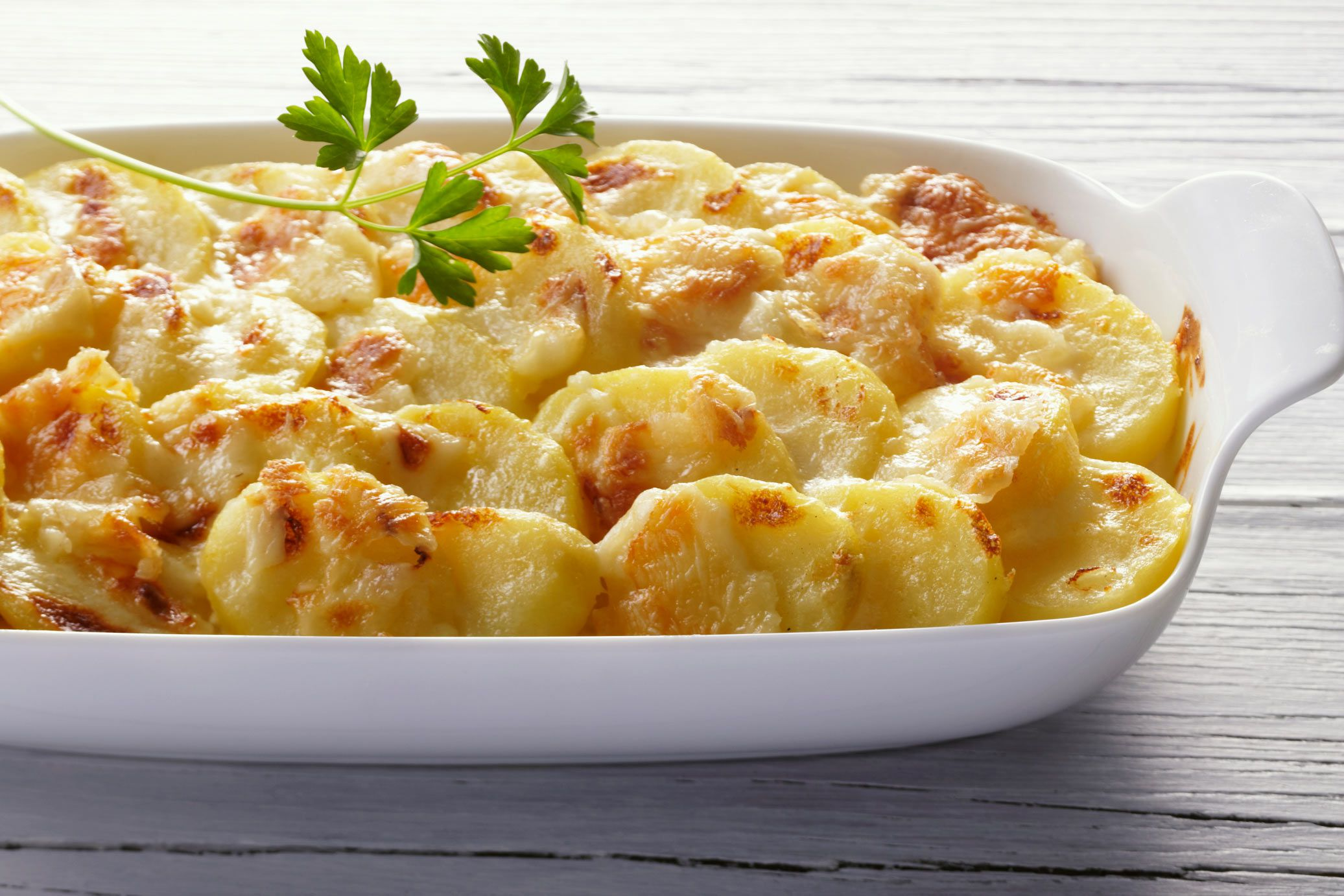 Creamy Scalloped Potatoes With White Sauce And Cheese