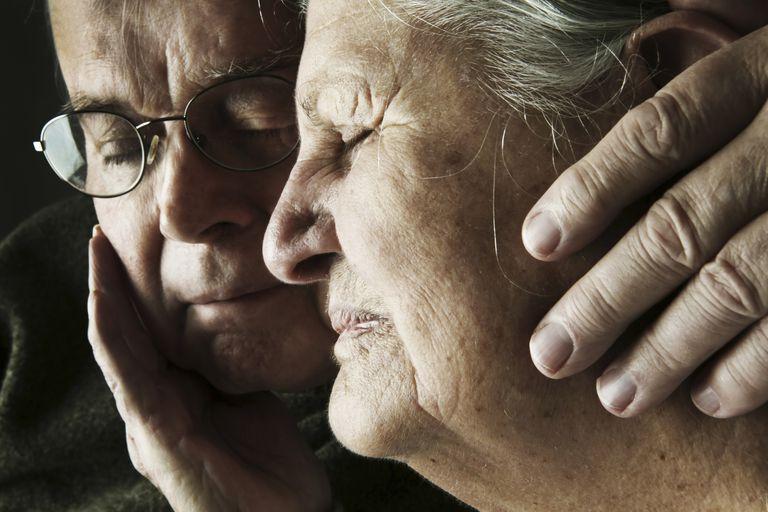 Portrait of senior couple with close eyes, close-up
