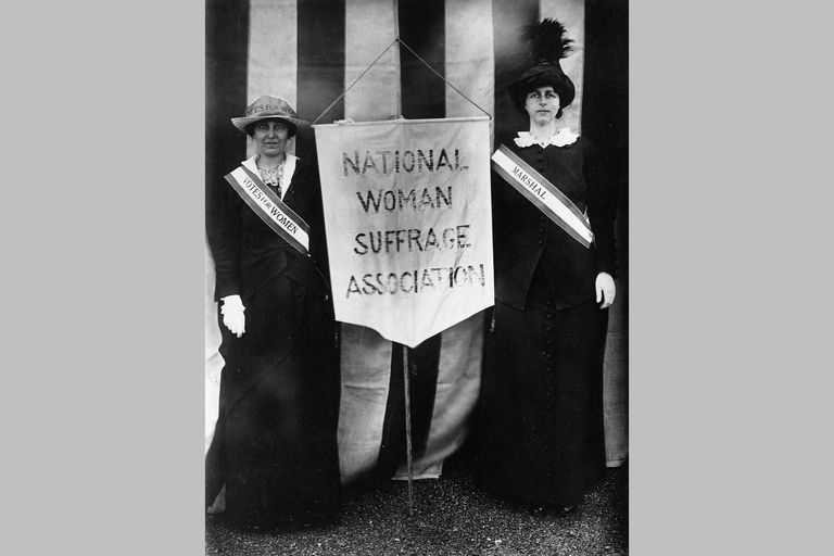 Mrs. Stanley McCormick and Mrs. Charles Parker holding a banner representing the National Woman Suffrage Association