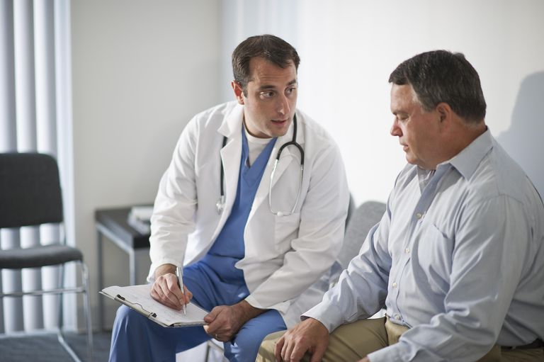 Doctor discussing medical results with male patient in hospital