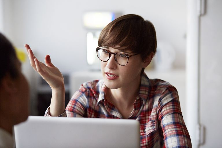 Creative businesswoman explaining to coworker