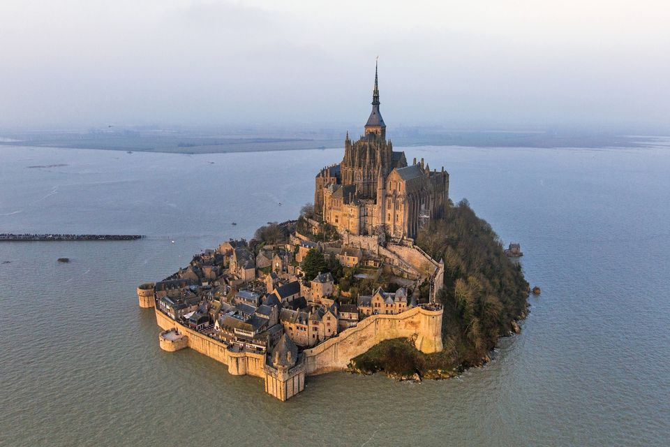 France, Manche, Bay of Mont Saint Michel, listed as World Heritage by UNESCO, the Mont Saint Michel, the spring tide of 21 March 2015 (aerial view)