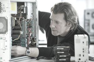 man repairing computer