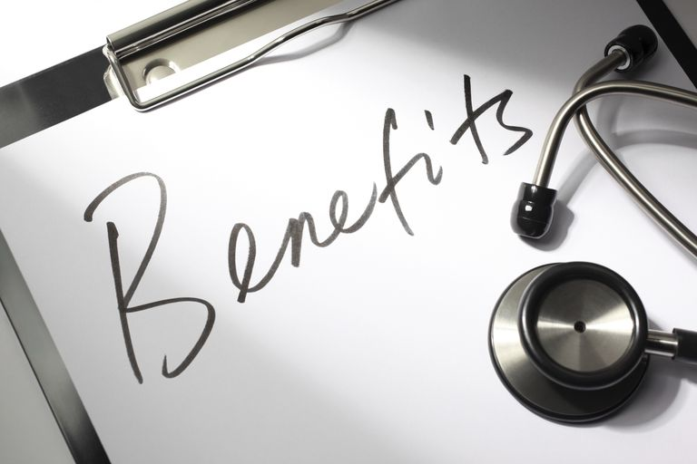 Image of employee benefits clipboard with stethoscope.