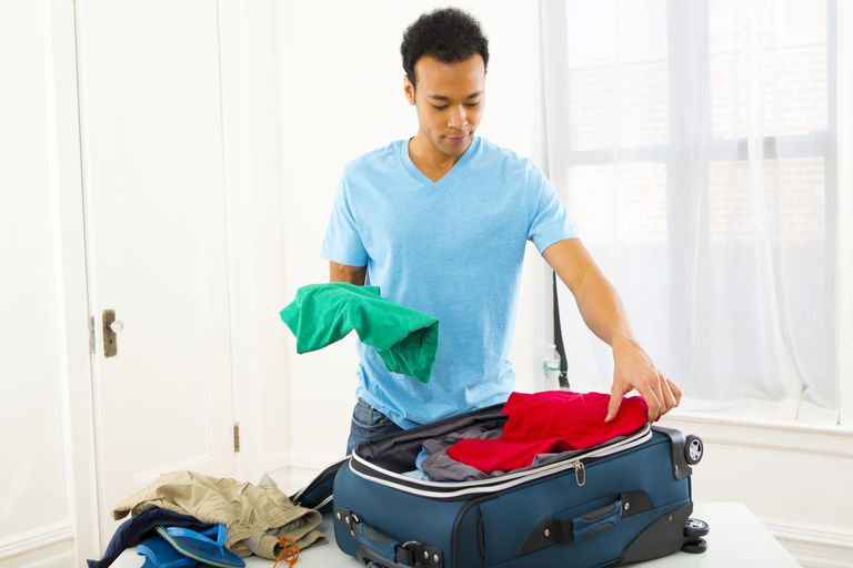 man packing suitcase