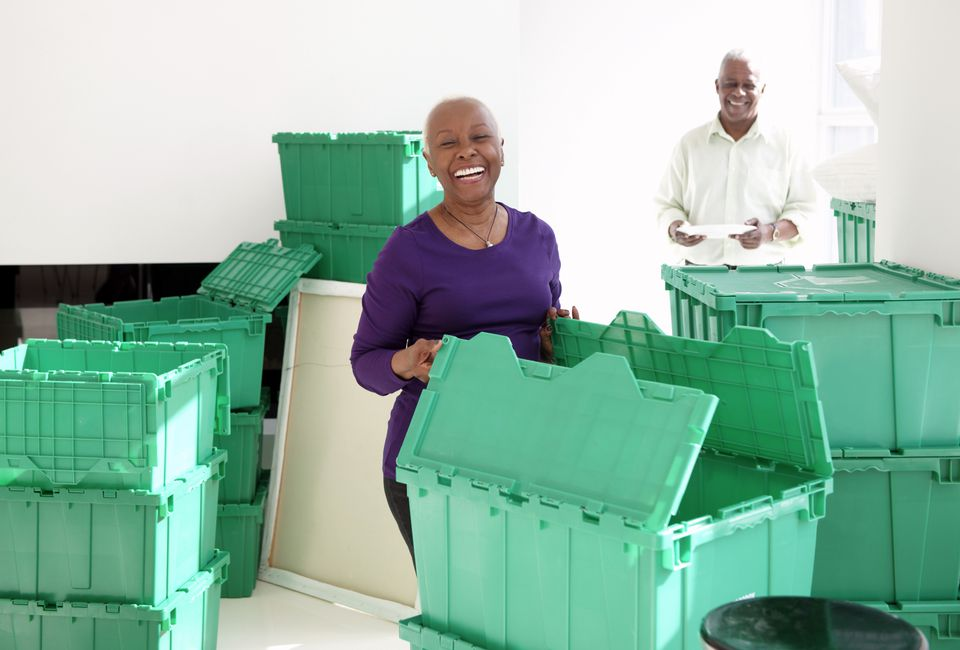 African American couple packing using green plastic bins