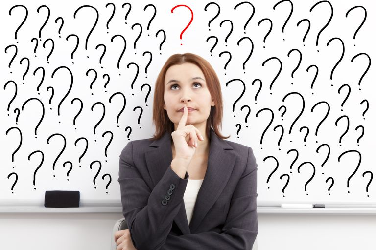 Woman with thoughtful expression surrounded by question marks