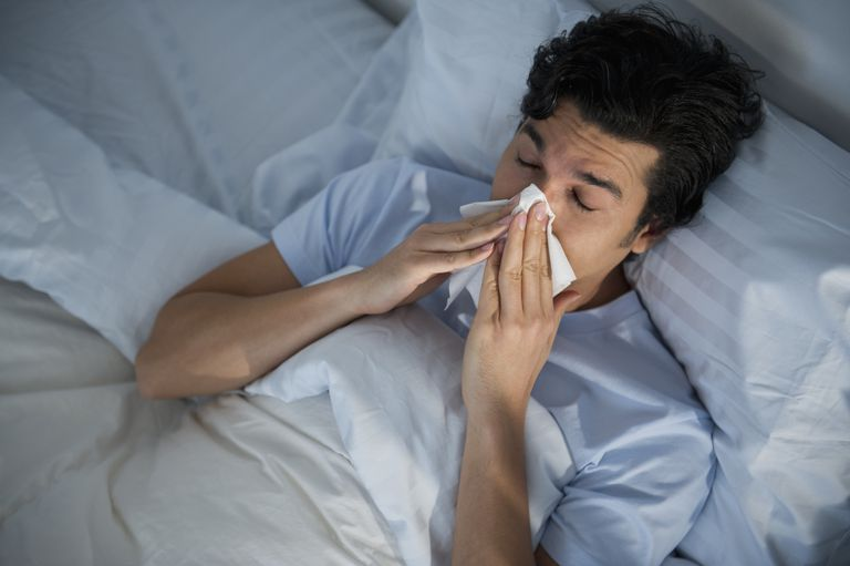 Man sick in bed