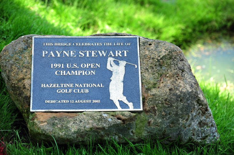 A plaque indicates that a bridge was named in honor of 1991 U.S. Open Champion Payne Stewart at Hazeltine National Golf Club