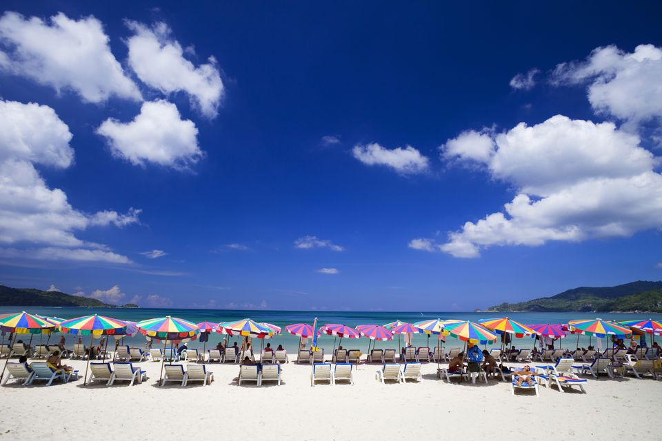 Colorful umbrellas line Patong Beach in Phuket, Thailand
