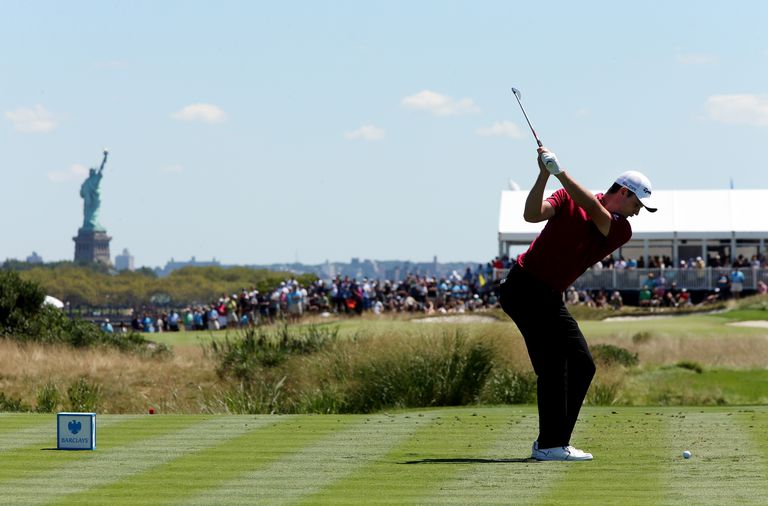 Justin Rose of England tees off on the second hole during the third round of The Barclays at Liberty National Golf Club on August 24, 2013