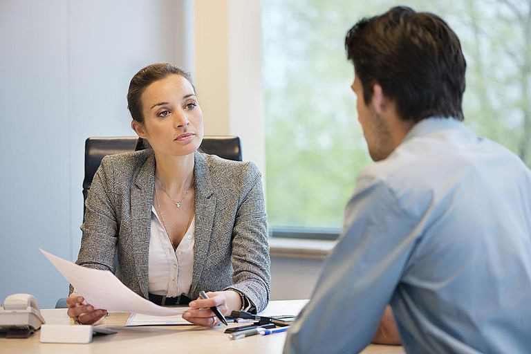 Business woman talking with employee or client