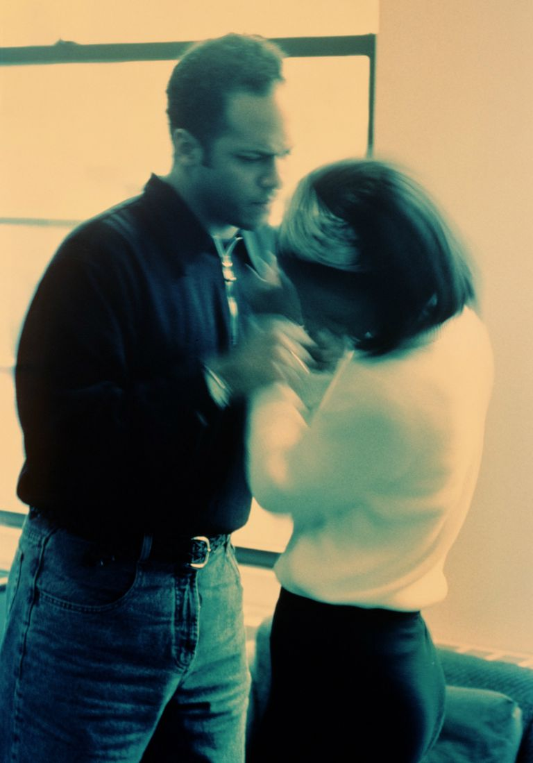 Man assaulting woman (blurred motion, cyan tone