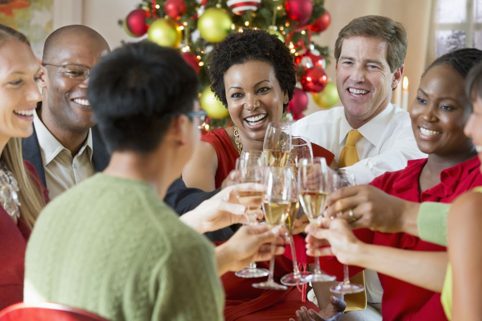Group of friends toasting during a holiday party