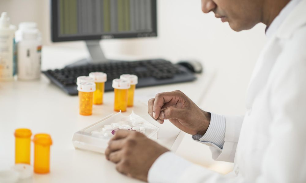 pharmacist preparing prescription pills