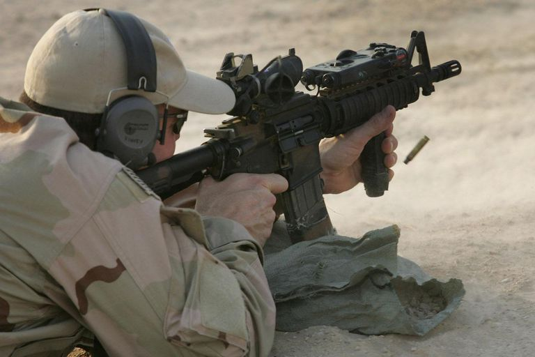 FALLUJAH, IRAQ - JULY 26: A U.S. Navy SEAL fires his M-4 assault rifle during a training session with Iraqi army scouts July 26, 2007 in Fallujah, Iraq.