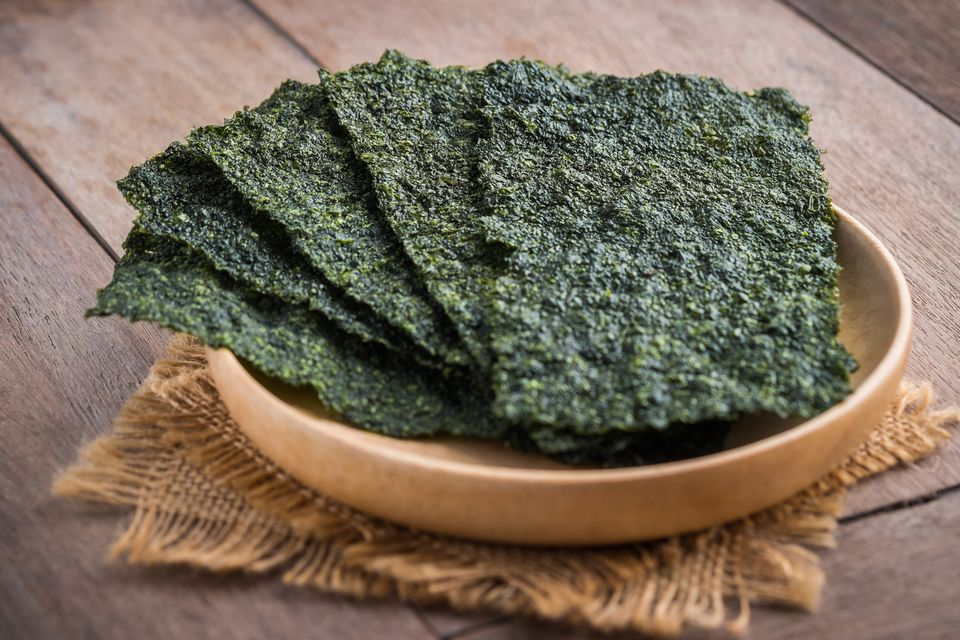 Picture of nori sheets in a wooden serving bowl