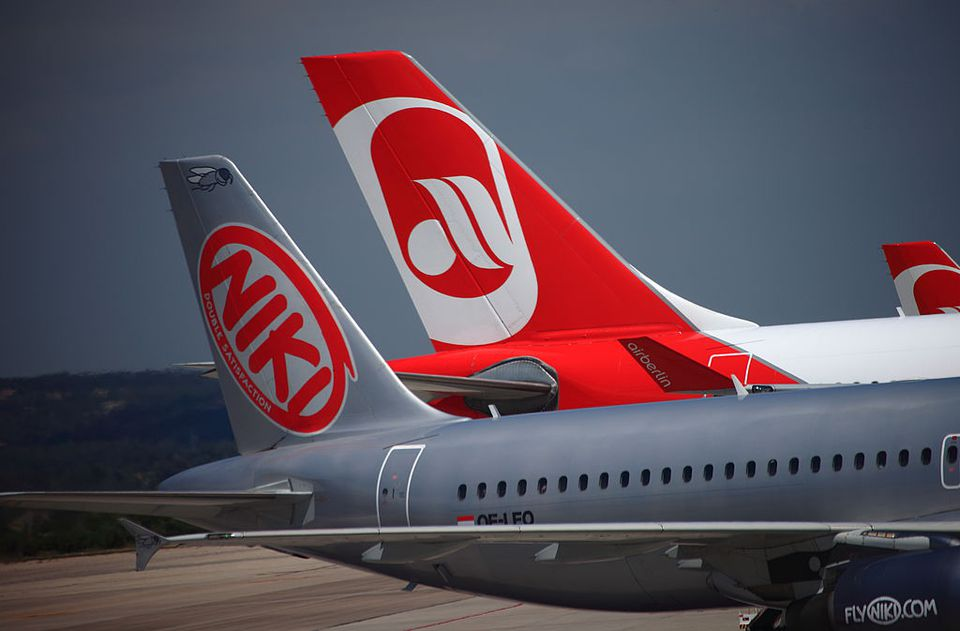 A passenger jet from the Austrian airline NIKI (owner Niki Lauda), a partner of the German airline Air Berlin, sits on the tarmac after landing at the airport (Aeropuerto de Son Sant Joan) on May 25, 2010 of Palma de Mallorca, Spain