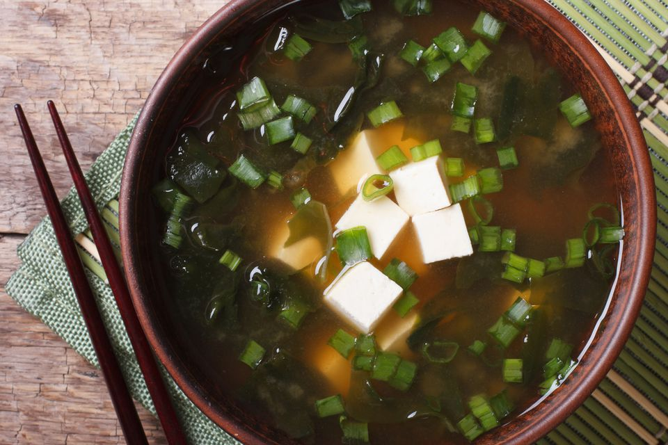 miso soup in a brown bowl close-up. horizontal top view