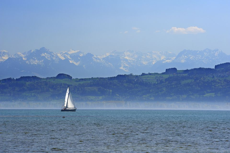 Sailing boat with Swiss Alps in the background, lake Constance, Wasserburg, Lindau, Bavaria, Germany