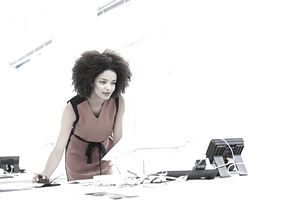 Creative woman working in open plan office.