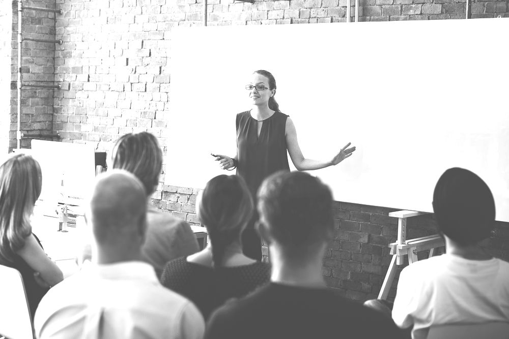 Woman leading meeting at business