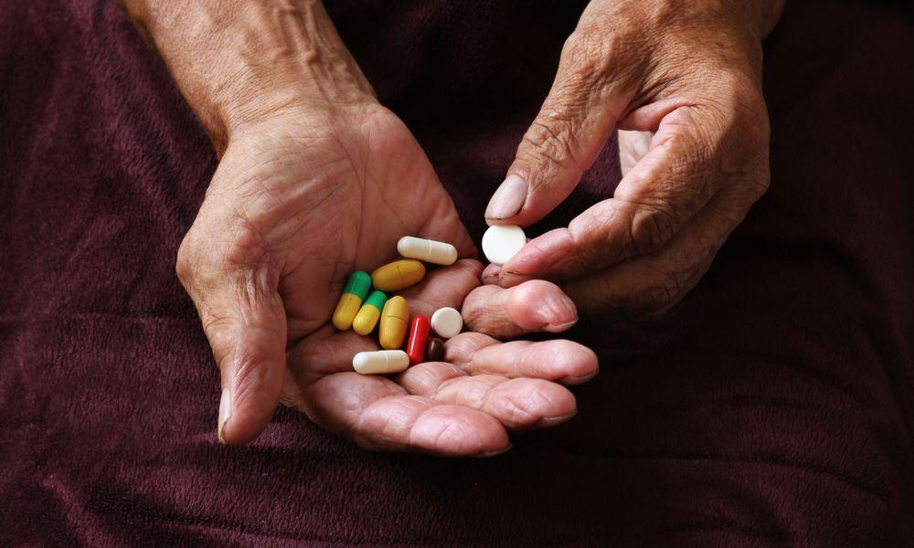Man holding pills