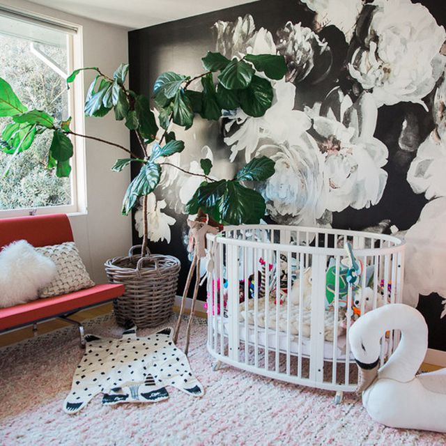 Modern nursery with black and white floral accent wall
