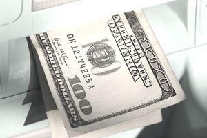 Hundred dollar bills emerging from ATM