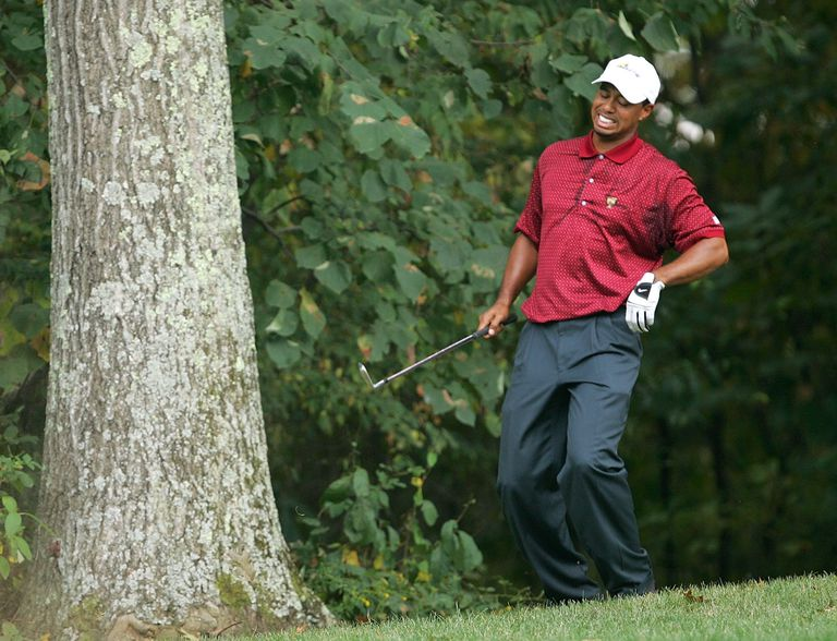 Tiger Woods winces with back pain, one of many injuries he's had along with multiple surgeries