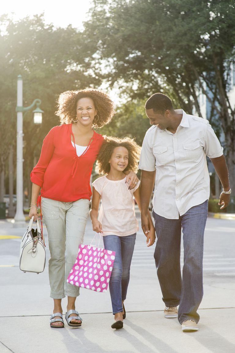 Smiling family shopping