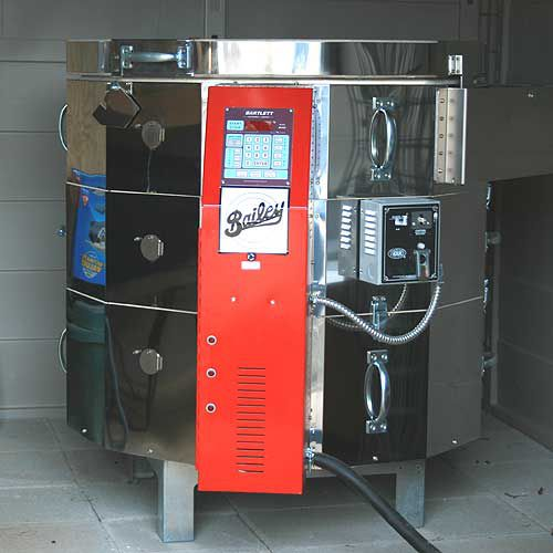 This is a ten cubic foot electric kiln with controller and kiln sitter.