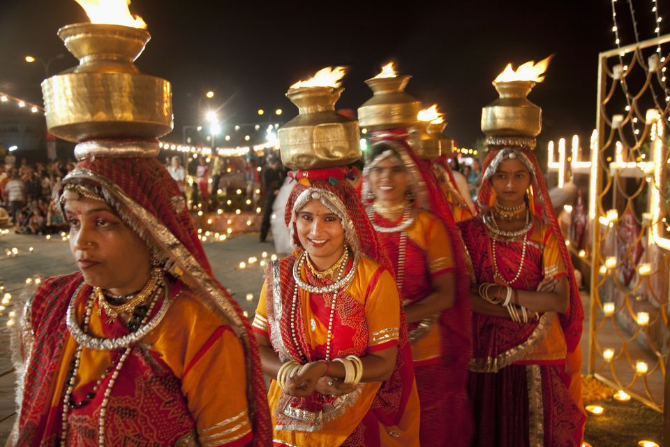 Four women take part in a diwali celebration.