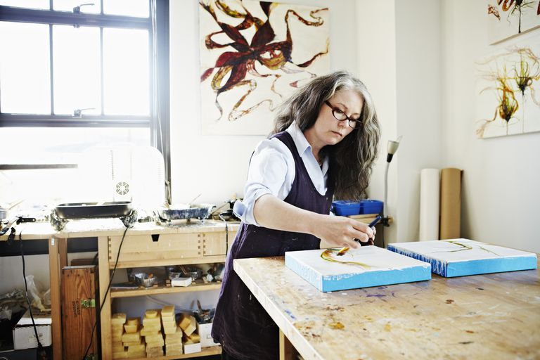 Female painter working on painting in studio