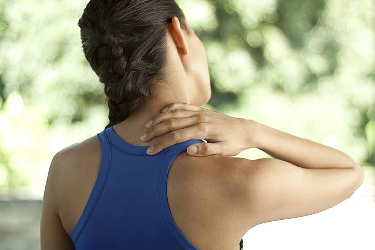 Young woman in sportswear with neck pain. You may also like: