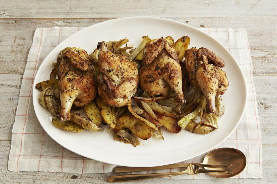 Roasted cornish hens on white platter
