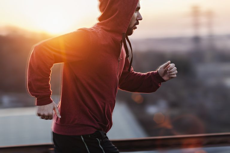 Man running while the sun sets